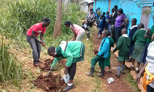 Children from Compassion CBO plant trees